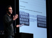 Apple Senior VP of iPhone Software Scott Forstall demonstrates a new keyboard on the iPad for typing with thumbs as he announces the new iOS5 during...