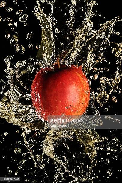Apple splash by apple juice, close-up.