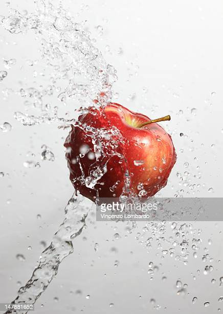 Apple splashed with water
