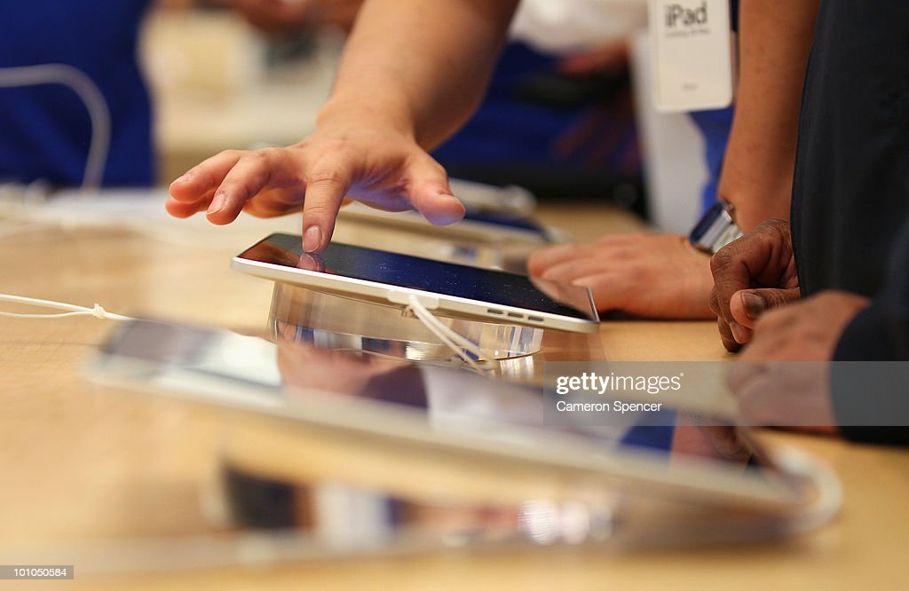 Apple staff demonstrate features on the new iPad at the Apple store on George Street on May 28, 2010 in Sydney, Australia. Apple's new tablet media device went on sale in nine countries around the world today following its launch in the United States in April this year.