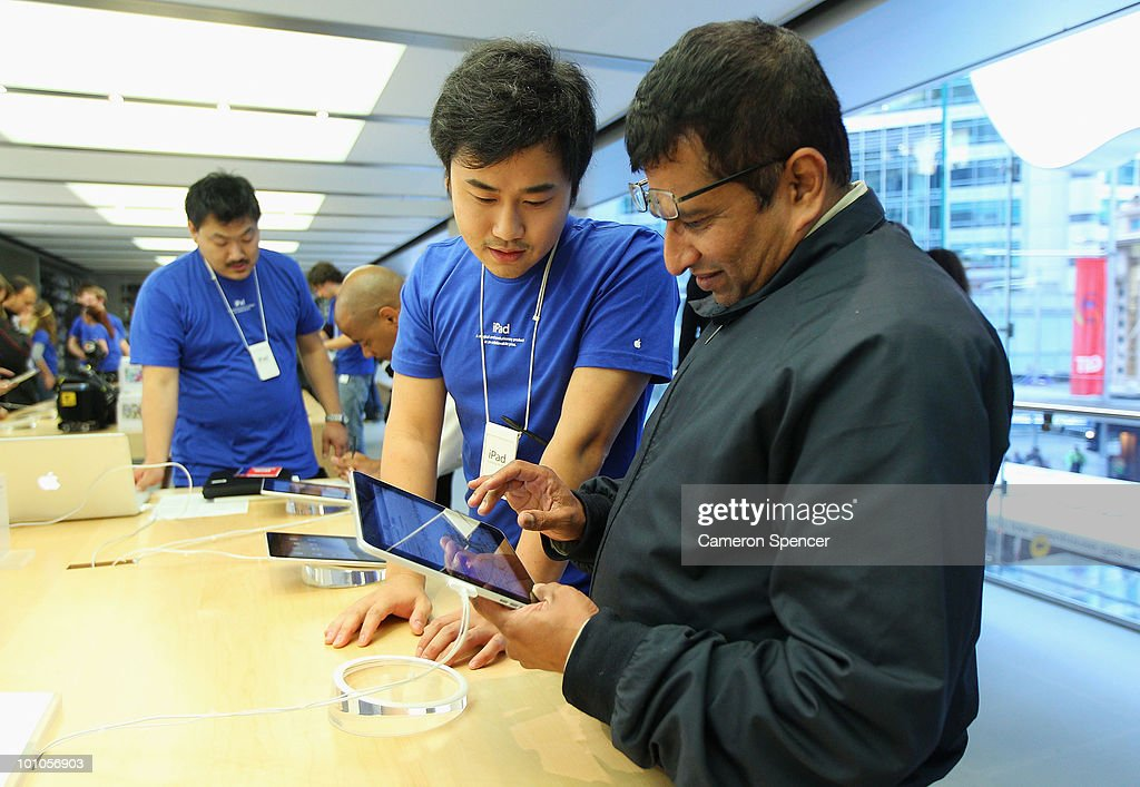 Apple staff demonstrate features on the new iPad to customers at the Apple store on George Street on May 28, 2010 in Sydney, Australia. Apple's new tablet media device went on sale in nine countries around the world today following its launch in the United States in April this year.