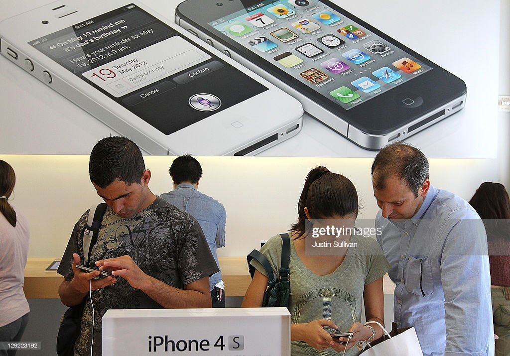 Apple Store customers look at the new Apple iPhone 4Gs on October 14, 2011 in San Francisco, United States. The new iPhone 4Gs went on sale today and features a faster dual-core A5 chip, an 8MP camera that shoots 1080p HD video, and a voice assistant program.