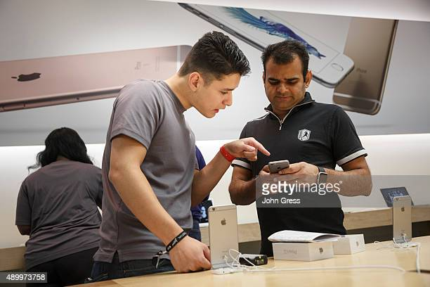 Apple store employee Cristian Zuniga shows the new iPhone 6s to Rajeev Sharma On September 25 2015 in Chicago Illinois Apple launched the new iPhone...