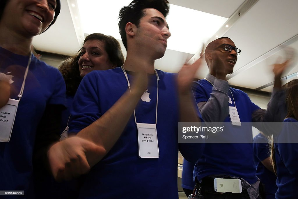Apple Store employees cheer as the first customers in line walk into the store to purchase the new iPad Air, the fifth generation of its tablet on November 1, 2013 in New York City. The new iPad, which will also come in a mini version, is 20% thinner and 28% lighter than the current fourth-generation iPad. It has the same 9.7-inch screen as previous iPads and uses the same A7 processing chip that's in the iPhone 5S. The iPad Air, which went on sale today, will start at $499 for a 16GB Wi-Fi-only model and go up to $629 for a 16GB with 4G LTE connectivity.