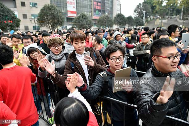 Apple Store employees greet customers during the grand opening of an Apple Store in Jiefangbei Yuzhong District on January 31 2015 in Chongqing...