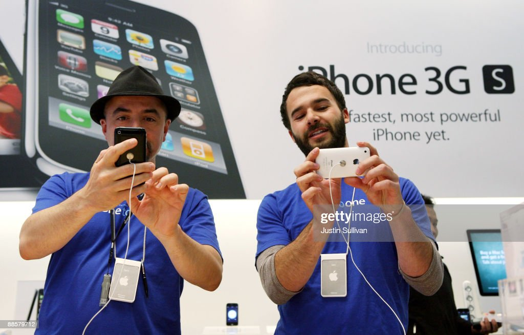 Apple Store employees Sam Coniglio and Ian Levine inspect the new iPhone 3Gs at an Apple Store June 19 2009 in San Francisco California Hundreds of...