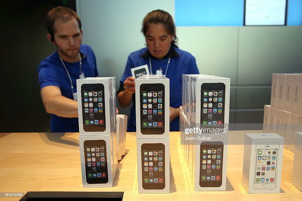 Apple Store employees stack boxes of the new Apple iPhone 5S on September 20, 2013 in Palo Alto, California. Apple launched two new models of iPhone: the iPhone 5S, which is preceded by the iPhone 5, and a cheaper, paired down version, the iPhone 5C. The phones come with a new operating system.