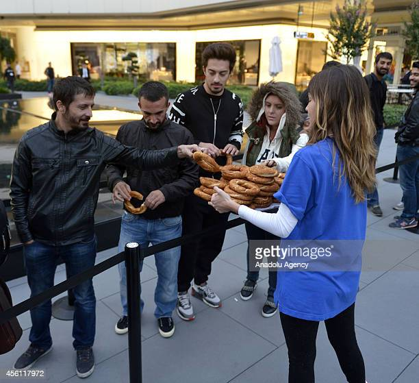Apple Store serves bagels to customers who waiting outside Zorlu Center as iPhone 6 and iPhone 6 Plus retail sales begin at Apple Store in Zorlu...