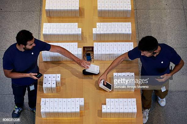 Apple Store staff members arrange new Iphone and Iphone 7 Plus stacked at a desk at Puerta del Sol Apple Store the day the company launches their...