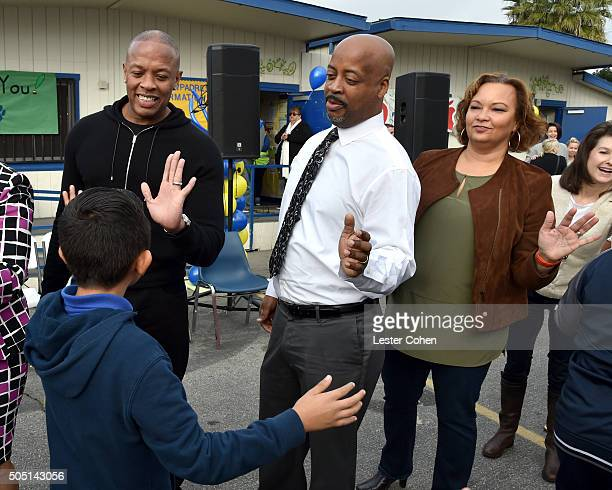 Apple Vice President of Environment Policy and Social Initiatives Lisa Jackson CUSD Director of Technology Kevin Evans and Dr Dre help distribute...