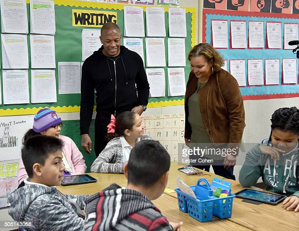 Apple Vice President of Environment Policy and Social Initiatives Lisa Jackson and Dr Dre help distribute iPads to students at Jefferson Elementary...