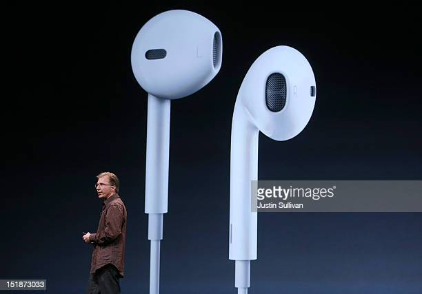 Apple Vice President of iPod and iPhone Product Marketing Greg Joswiak announces new Apple earphones called EarPods during an Apple special event at...