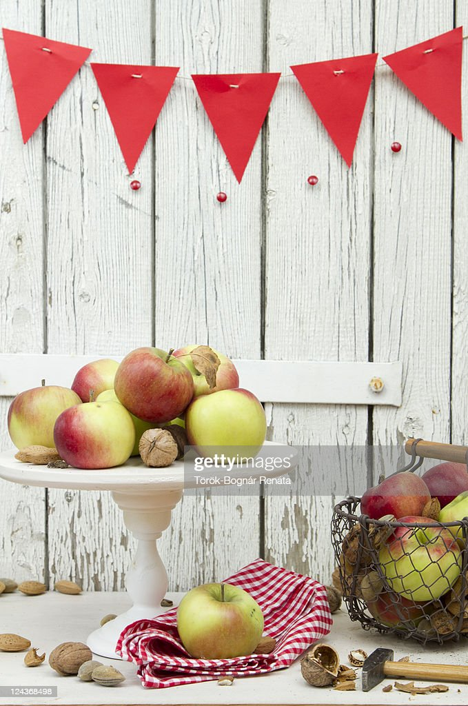 Apple, walnut and almond on white cake stand