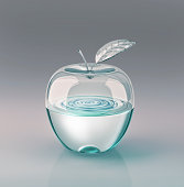 Apple with leaf, made of glass and half filled of clear water. At grey neutral background. With clipping path included.