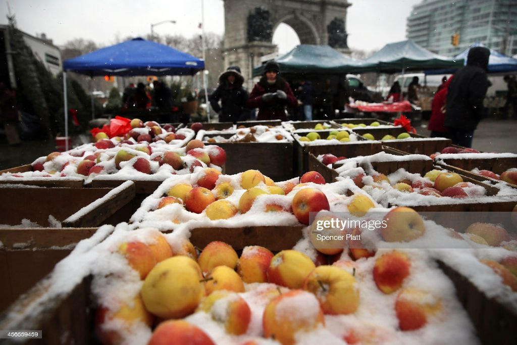 Apples covered with snow are viewd for sale in a market during a snow storm on December 14, 2013 in the Brooklyn borough of New York City. Much of the Northeast was hit by a storm stretching over 1,000 miles that could result in at least a foot of snow on parts of New England.