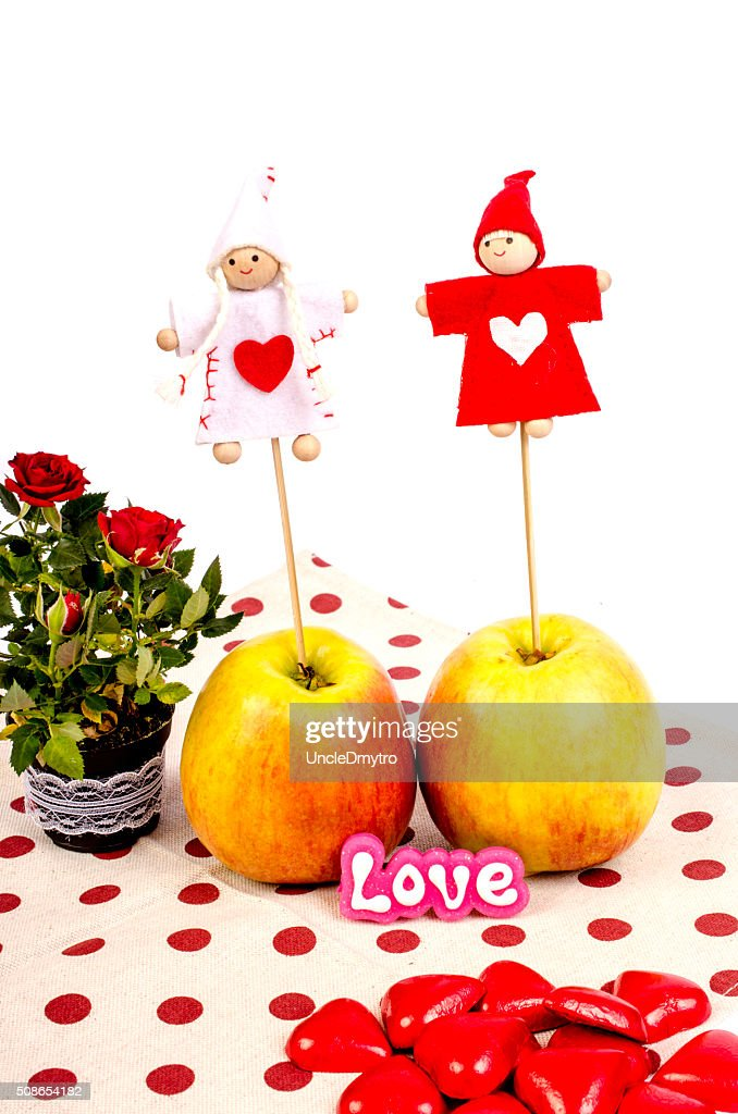 Apples, flowers and hearts on napkin with polka dots. : Stock Photo