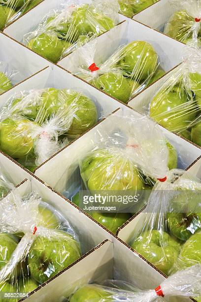 Apples in packing boxes