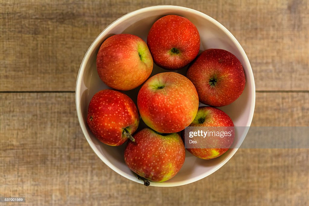 Apples in white fruit bowl
