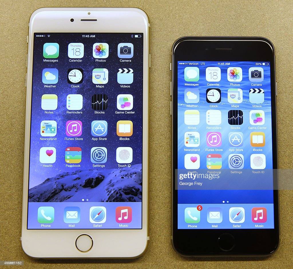 Apple's iPhone 6 and iPhone 6 Plus are shown together at a Verizon store on September 18 2014 in Orem Utah Apples new iPhone 6's go on sale tomorrow...