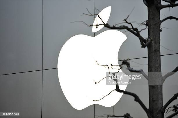 Apple's logo is seen at the entrance of an Apple Store in the popular shopping district of Shibuya in Tokyo Japan on March 19 2015 Apple stores are...