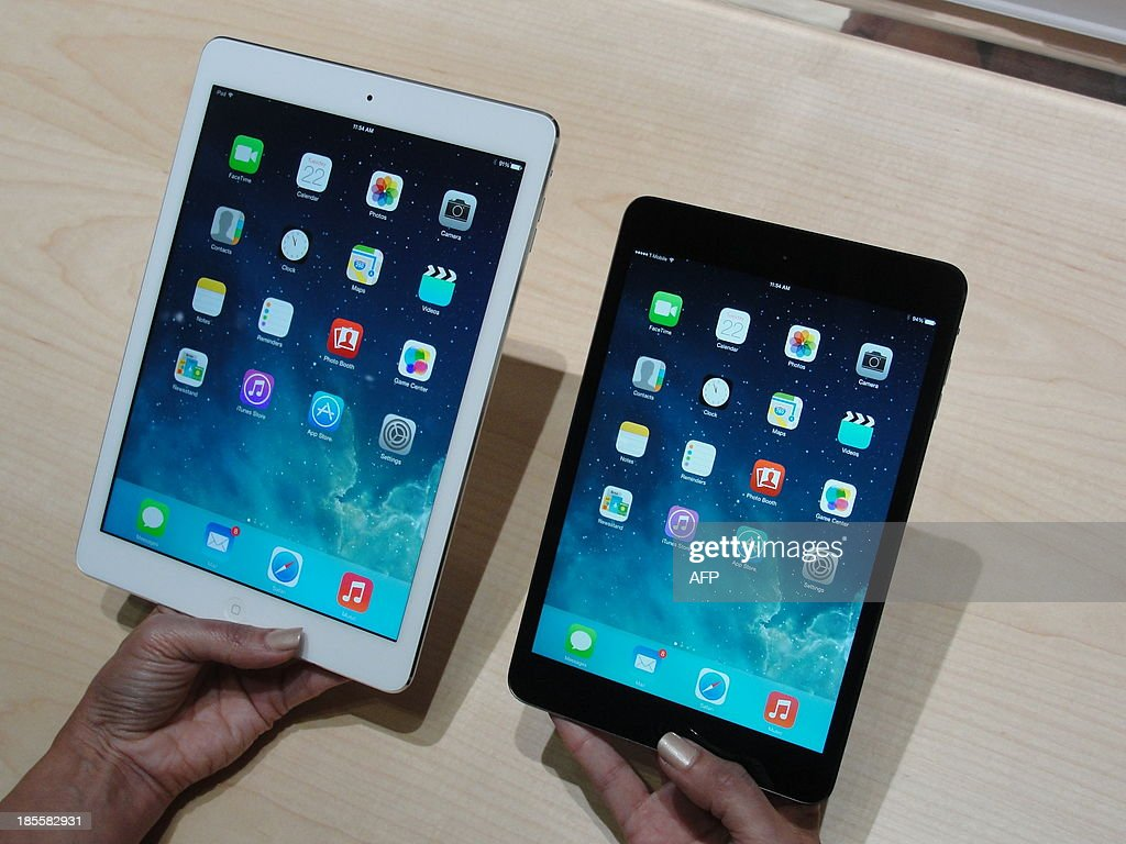 Apple's new iPad Air (L) and iPad Mini tablets are seen on October 22, 2013 in San Francisco, California. Apple unveiled upgraded versions of its iPads, with more power and sleeker designs to ramp up competition against rivals who now have a majority of the tablet market. A slimmer version of its top-selling full-size tablet computer, dubbed the 'iPad Air,' was announced along with a revamped iPad Mini with an improved high-definition display. The new iPad Air is 43 percent thinner than the version it replaces, weighs just one pound (450 grams), and is 'screaming fast,' Apple vice president Phil Schiller said at an unveiling. The upgraded iPad Mini has a high-definition 'retina' display along with faster computing power and graphics.
