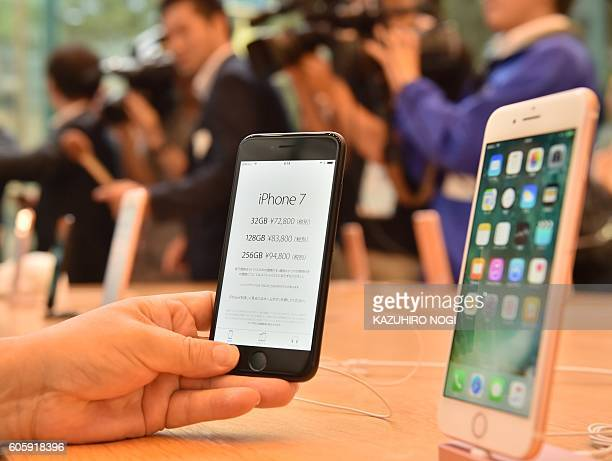 Apple's new iPhone 7 and 7 Plus are displayed at the company's flagship store in Tokyo on September 16 2016 With new iPhones hitting the markets on...