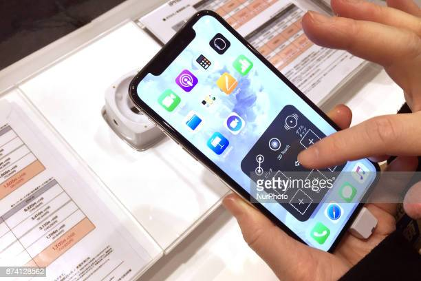 Apple's new iPhone X is displayed after it goes on sale at the Apple Store in Tokyo shopping district Japan November 14 2017