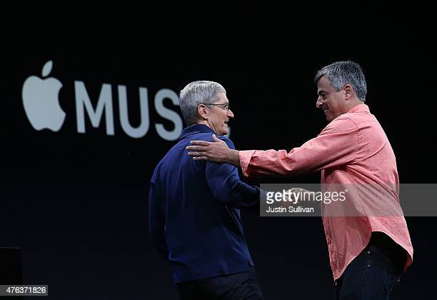 Apple's senior vice president of Internet Software and Services Eddy Cue greets Apple CEO Tim Cook during the Apple WWDC on June 8 2015 in San...