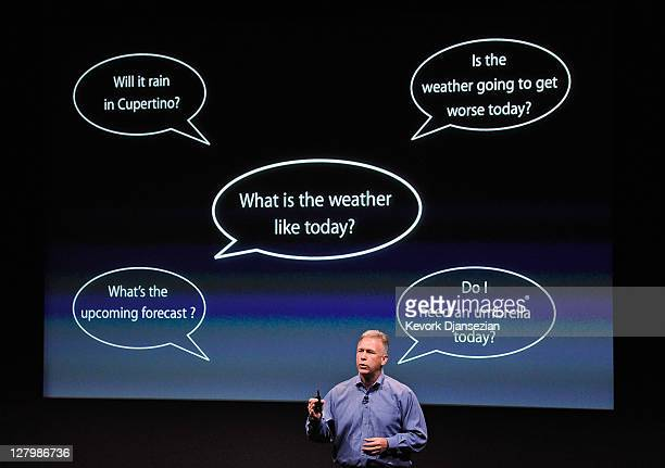 Apple's Senior Vice President of Worldwide product marketing Phil Schiller standing in front of an image showing thought bubbles discusses the new...
