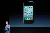 Apple's Senior Vice President of Worldwide product marketing Phil Schiller introduces the new iPhone 4s at the company's headquarters October 4 2011...