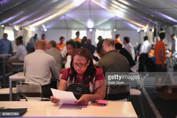 Applicants hoping to land 1 of the 2500 jobs being offered at the Amazon fulfillment center wait to take a facility tour on August 2 2017 in...