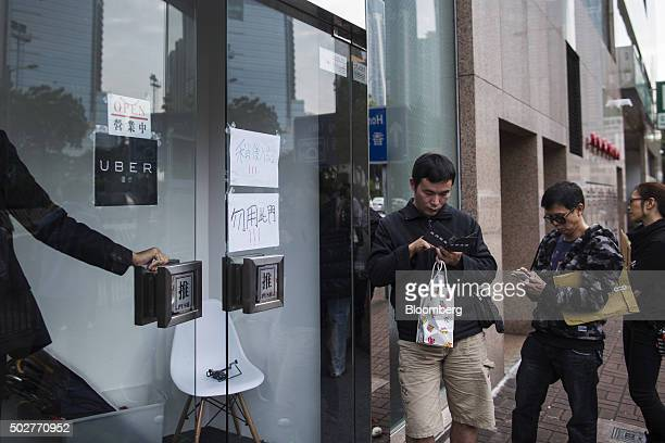 Applicants line up outside an Uber Technologies Inc office during a driver recruitment event in Hong Kong China on Tuesday Dec 29 2015 Uber is in the...