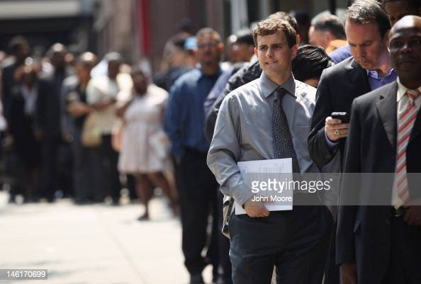 Applicants wait to enter a job fair on June 11 2012 in New York City Some 400 people arrived early for the event held by National Career Fairs and up...