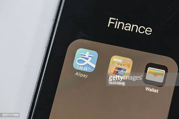 Application icons for Ant Financial Services Group's Alipay an affiliate of Alibaba Group Holding Ltd left China UnionPay Co center and Apple Inc...