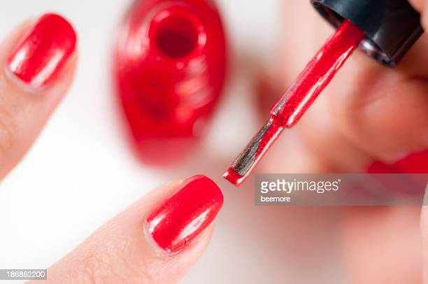 Apply Red Nail Polish
