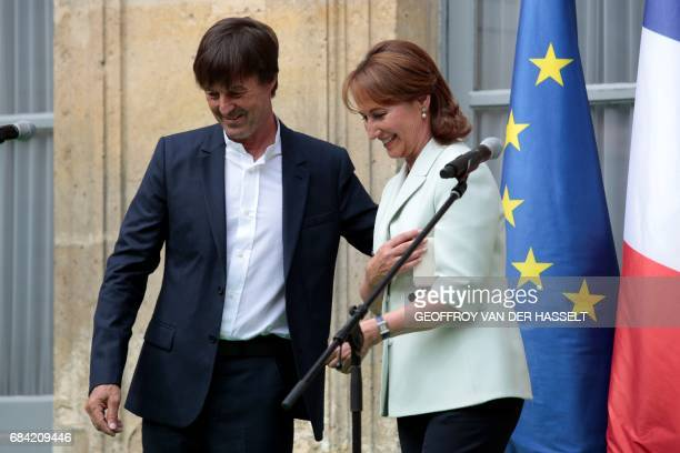Appointed French Ecology Minister Nicolas Hulot and outgoing French Minister for Ecology Sustainable Development and Energy Segolene Royal leave...