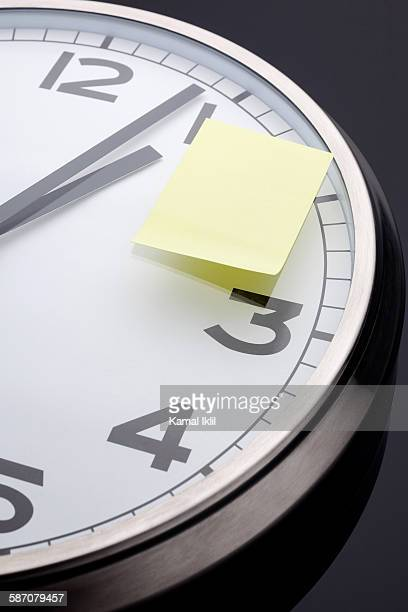 Appointment reminder. Clock with sticky note