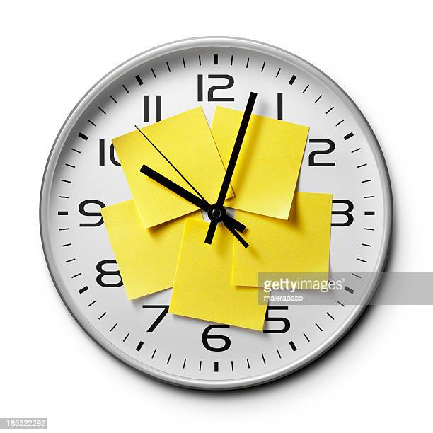 Appointment reminders. Clock with yellow sticky notes.