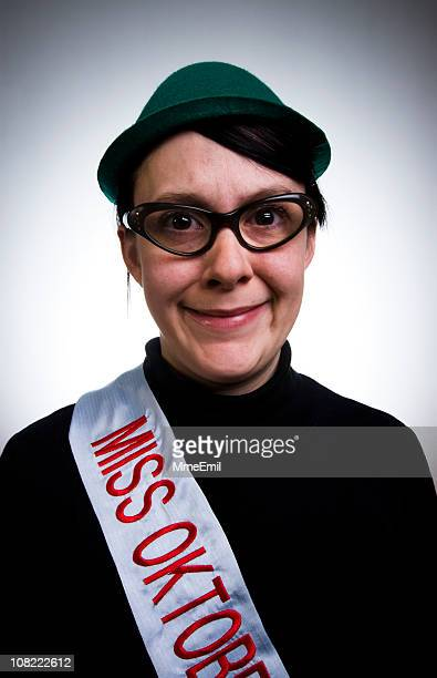 Apprehensive Woman Wearing Miss Oktoberfest Sash and Hat