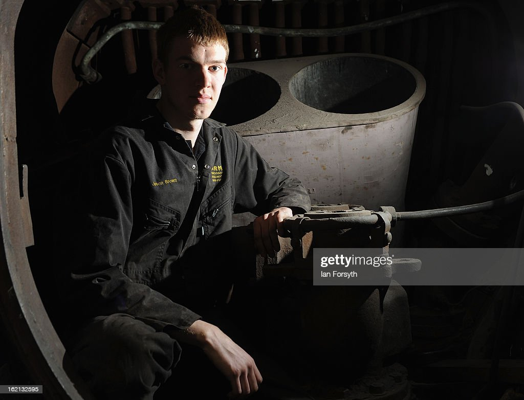Apprentice Jason Brown, 20, from Shildon poses inside the chimney of the locomotive Dominion of Canada as it undergoes restoration work on February 19, 2013 in Shildon, England. The Doncaster built engine which has come to the UK from Montreal, Canada is receiving a 'Mallard-style' makeover at the National Railway Museum at Shildon in time for the 75th anniversary celebrations of Mallard breaking the world steam speed record.