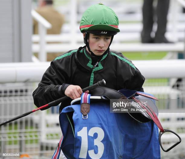 Apprentice jockey Ian Brennan in the unsaddling enclosure after finishing in second place on Violent Velocity in the Sign Up Bonus at betinternetcom...
