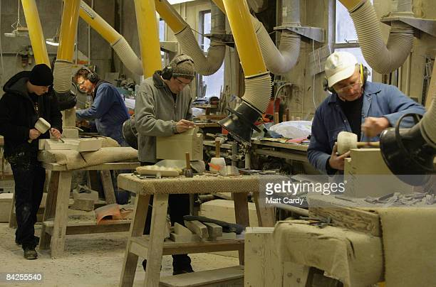 Apprentice mason Andrew Kirby works on a piece of stone as part of the ongoing restoration project at Salisbury Cathedral on January 12 2009 in...