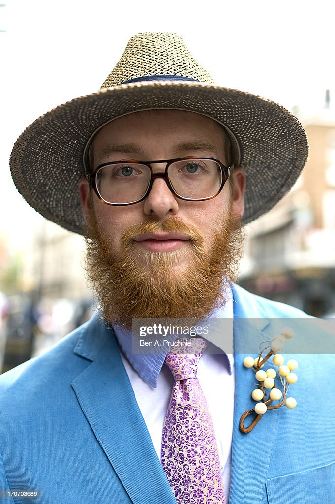 Apprentice tailor Morris Sedgwell (23) poses wearing Barker shoes, Penrose tie, and a vintage jacket and hat at the Jonathan Saunders catwalk presentation during London Collection:MEN SS14 at The London Film Museum on June 16, 2013 in London, England.