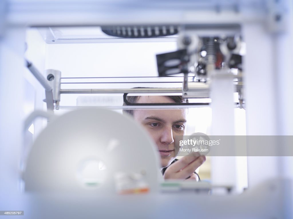 Apprentice with 3D printed part, close up : Stock Photo