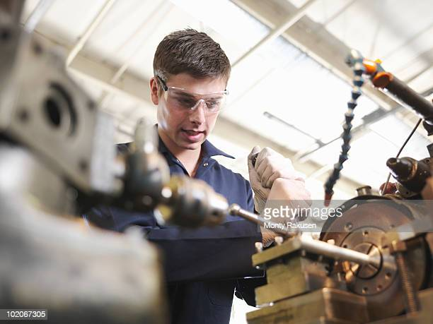 Apprentice Working With Lathe