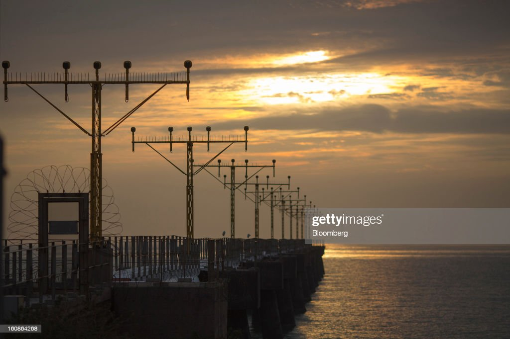 Approach lights stand on a pier outside Hong Kong International Airport in Hong Kong, China, on Thursday, Feb. 4, 2013. Cathay Pacific Airways Ltd. aims to replicate its business-class strategy in a cargo trade upgrade. Photographer: Jerome Favre/Bloomberg via Getty Images