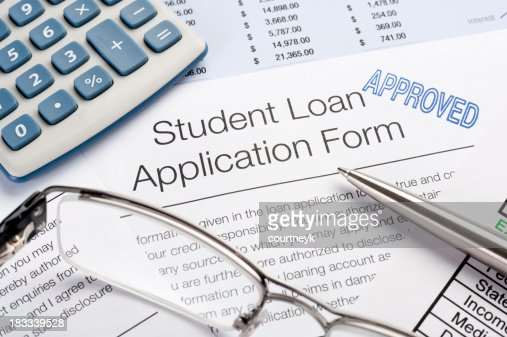 'Approved Student Loan application Form with pen, calculator'