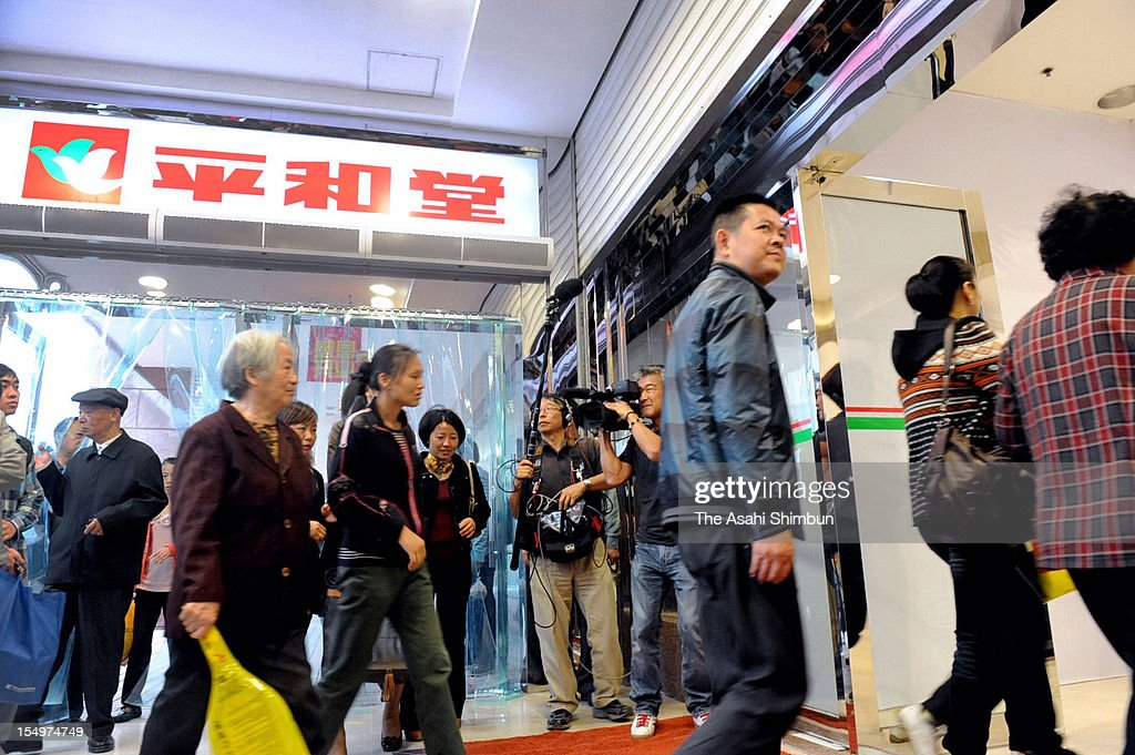 Approximately 100 customers enter to Japanese department store 'Heiwado' reopens on October 27, 2012 in Changsha, China. Heiwado managed to reopen one and a half months after suffering serious damages caused by antil Japanese demonstration.