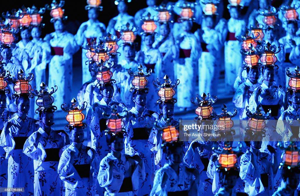 Approximately 1,000 women wearing Yukata, summer kimonos holding the Toro (lanterns) on their heads dance during the Yamaga Toro Festival at Yamaga Elementary School on August 16, 2014 in Yamaga, Kumamoto, Japan.