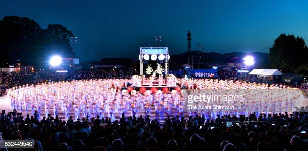 Approximately 1000 women wearing Yukata summer kimonos holding the Toro on their heads dance during the Yamaga Toro Festival at Yamaga Elementary...
